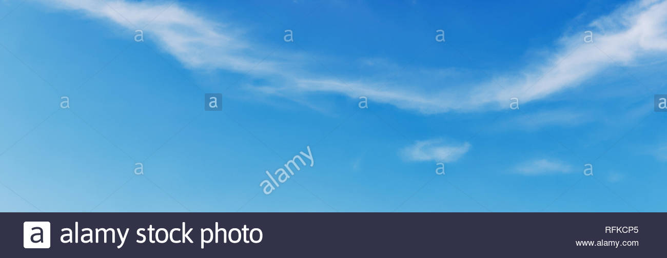 Vivid blue panoramic sky with cirrus clouds, wide angle - Stock Image
