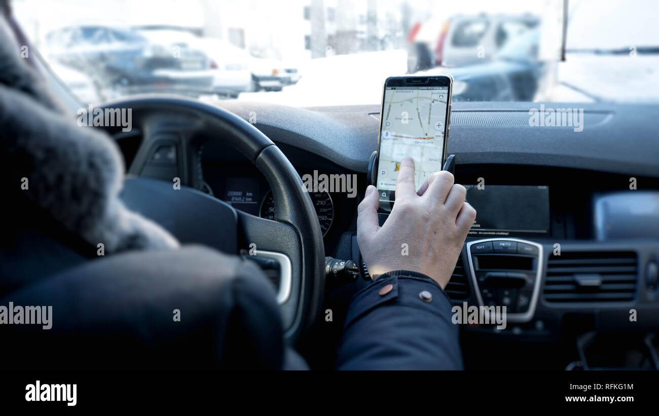 Transport, modern technology and people concept - male hand searching for route Stock Photo