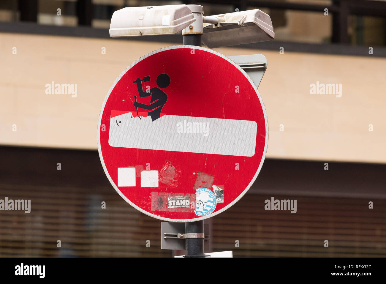 Clet Abraham art on street sign in the merchant city, area of Glasgow, Scotland, UK - Stock Image