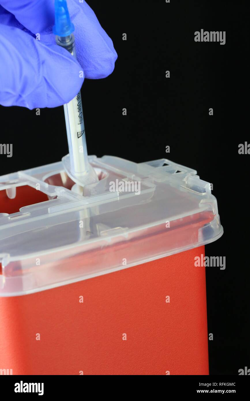Sharps container for bio hazard hypodermic needles - Stock Image