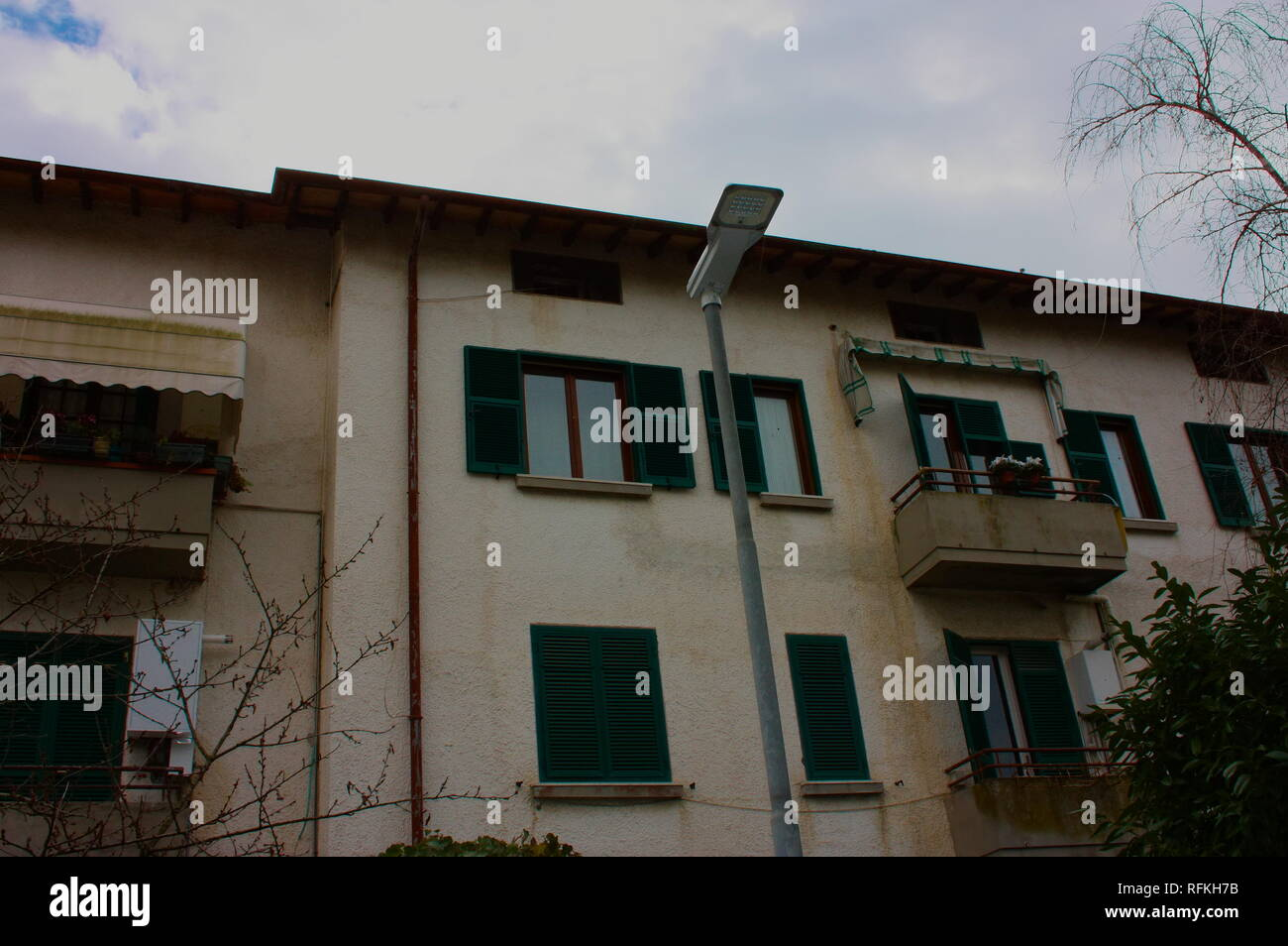 external facade of a house built in Italy. unknown Italian home. doors and windows. Stock Photo