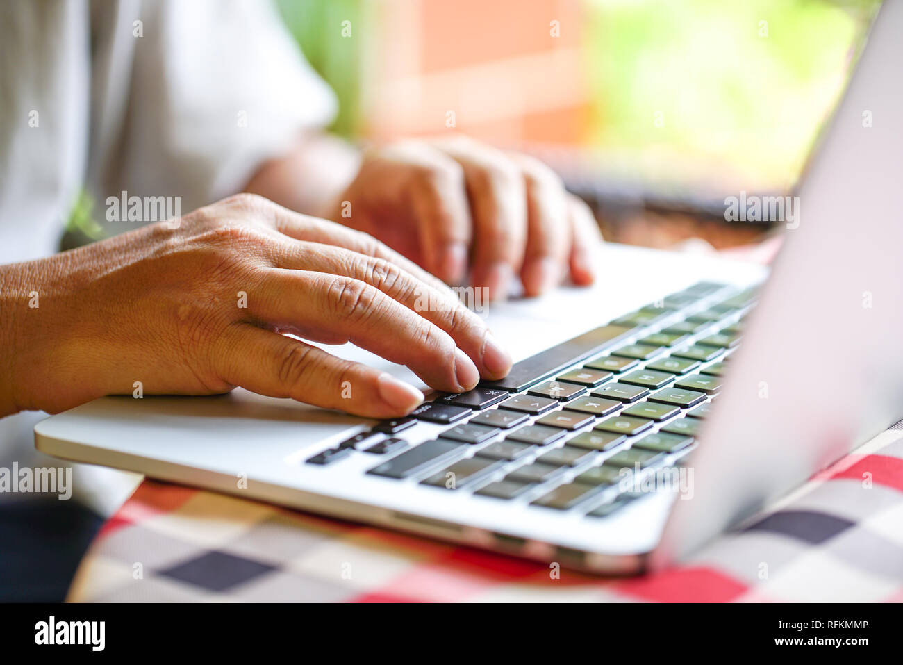 Working on the lap top - Stock Image