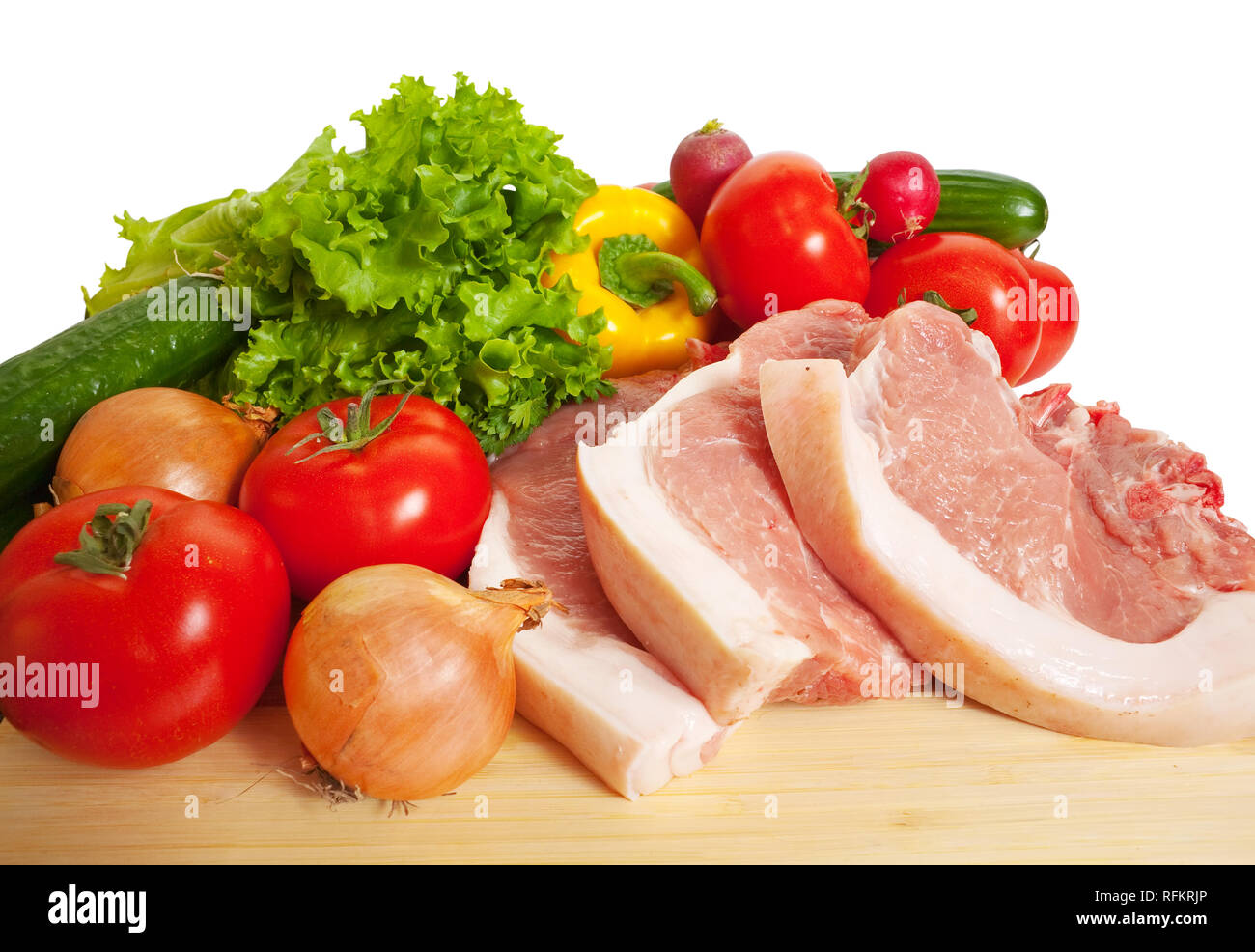 Raw pork and vegetables. Isolated over white Stock Photo