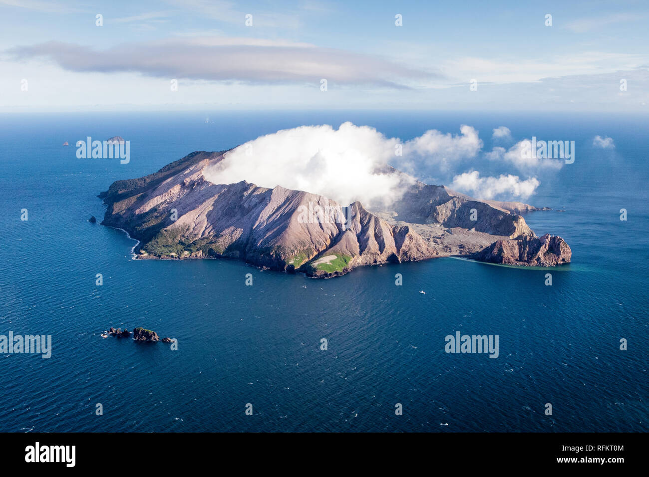Rugged and unpredictable, Whakaari or White Island draws scientists and visitors to see its amazing landscape. - Stock Image