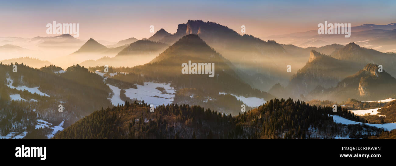 Fog in Pieniny mountains in sunset light, Poland - Stock Image