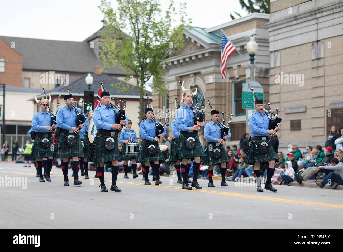 Stoughton, Wisconsin, USA - May 20, 2018: Annual Norwegian Parade, Men and woman playing bagpipes, wearing skirts and Viking helmets - Stock Image