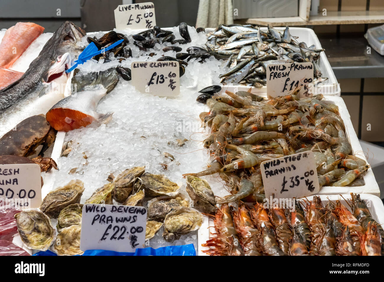 Clams and crustaceans for sale at a market - Stock Image
