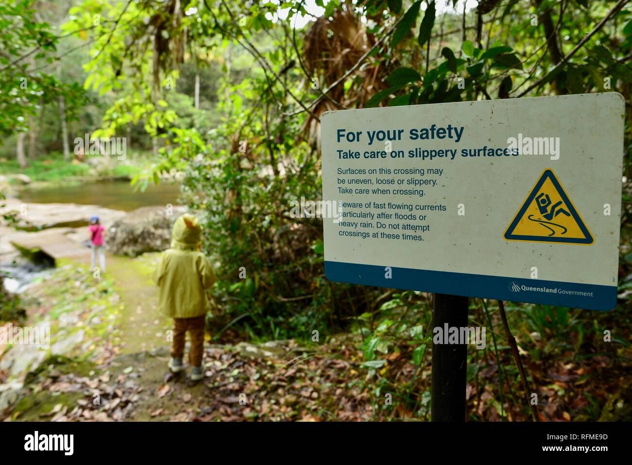 For your safety take care on slippery surfaces sign, Granite bend track to broken river, Eungella National Park, Queensland, Australia Stock Photo
