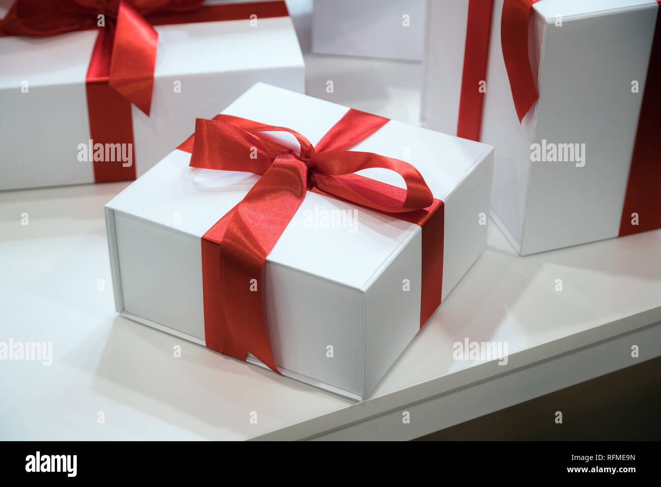 Christmas Or Birthday Time Gift Boxes With Red Ribbons On Wooden