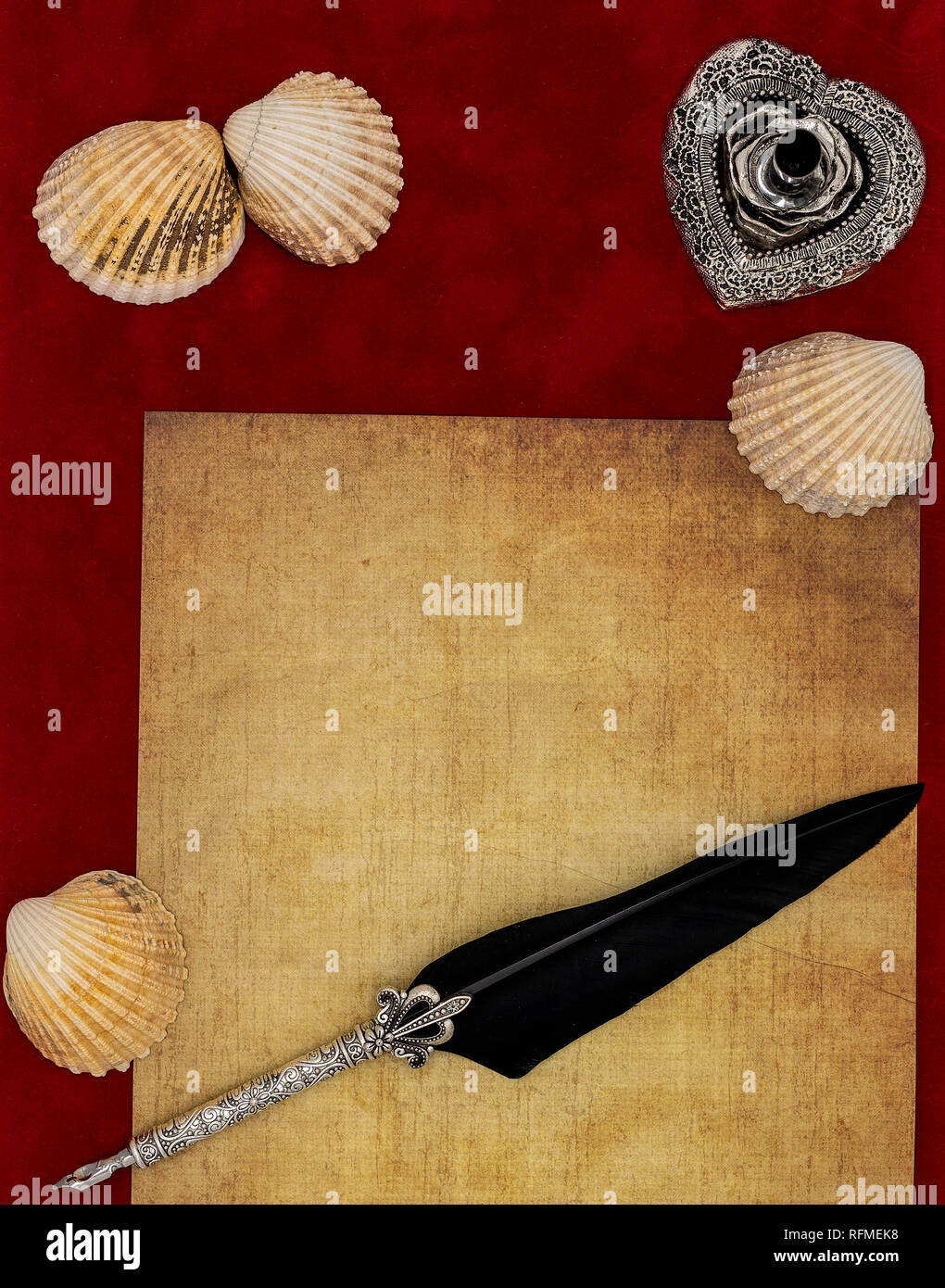 Classic Valentine's Day card idea vintage parchment seashells silver quill and stand blank love letter on burgundy velvet fabric top view - Stock Image