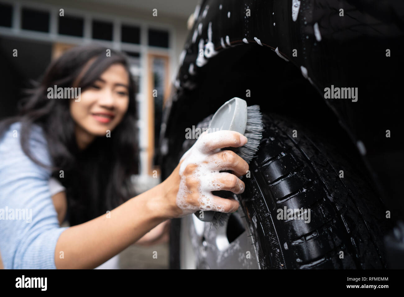 woman cleaning up her car  Stock Photo