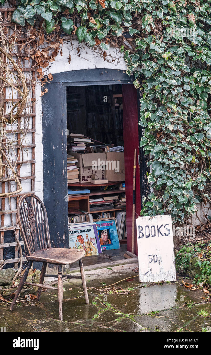 Presteigne, Powys, UK. The door into the cluttered interior of a secondhand bookshop in this small Welsh border town - Stock Image