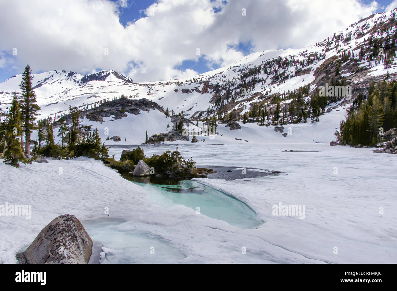 Views of frozen Fontanillis Lake and Dicks Peak in late Spring. - Stock Image