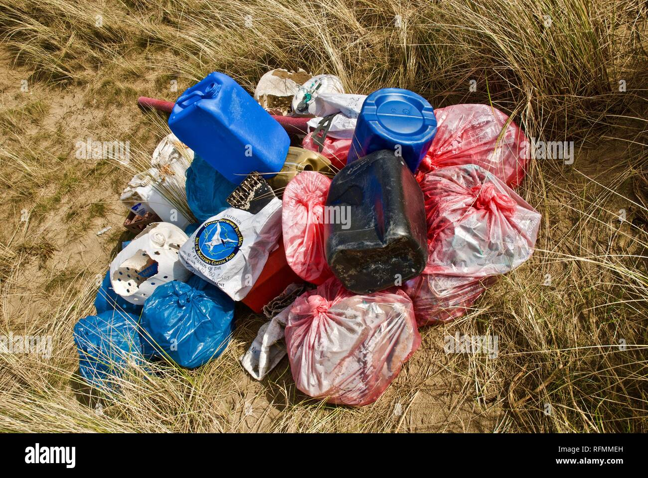 A beach collection of plastic waste and pollution washed up on a beach in Rhosneigr, Anglesey, North Wales, UK - Stock Image