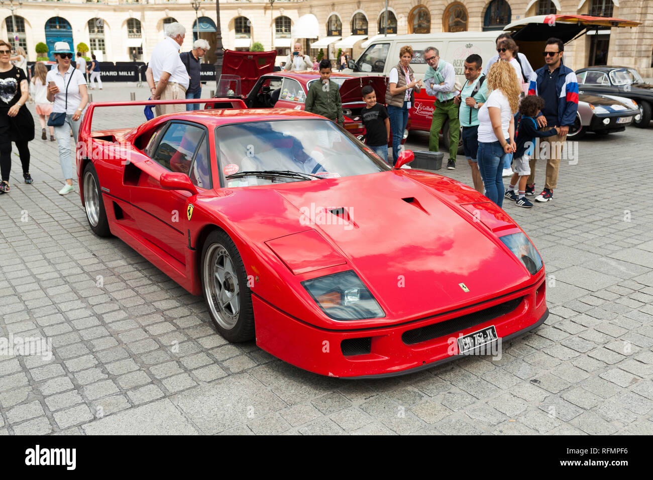 Paris, France 02 June 2018 classic vintage red Ferrari with driver behind the wheel at an exhibition of retro cars on the streets of Paris. - Stock Image