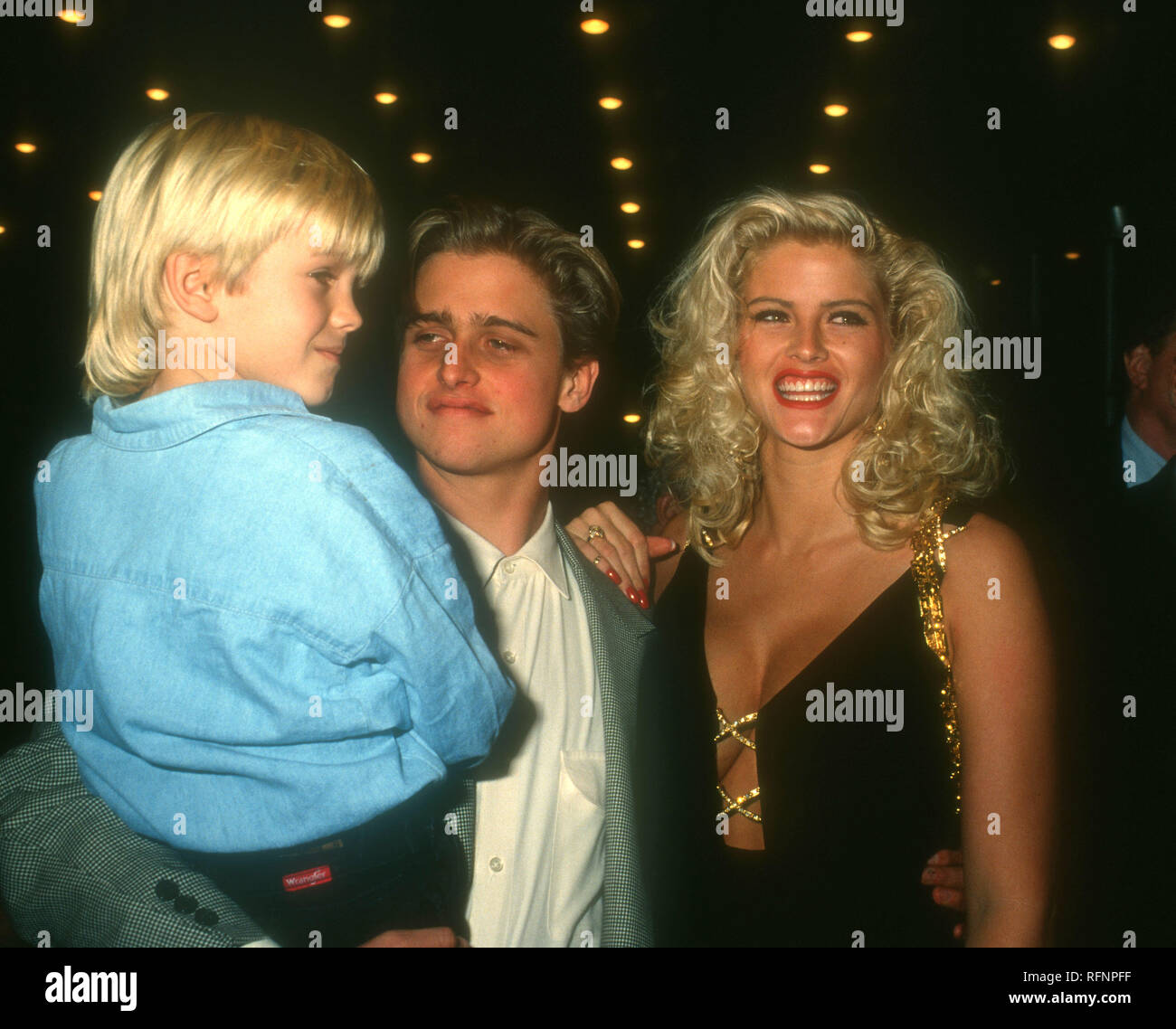 HOLLYWOOD, CA - NOVEMBER 11: Model/actress Anna Nicole Smith, brother Daniel Ross and son Daniel Smith attend Opening Night Party for 'Guys & Dolls' on November 11, 1993 at Club Tatou in Hollywood, California. Photo by Barry King/Alamy Stock Photo - Stock Image