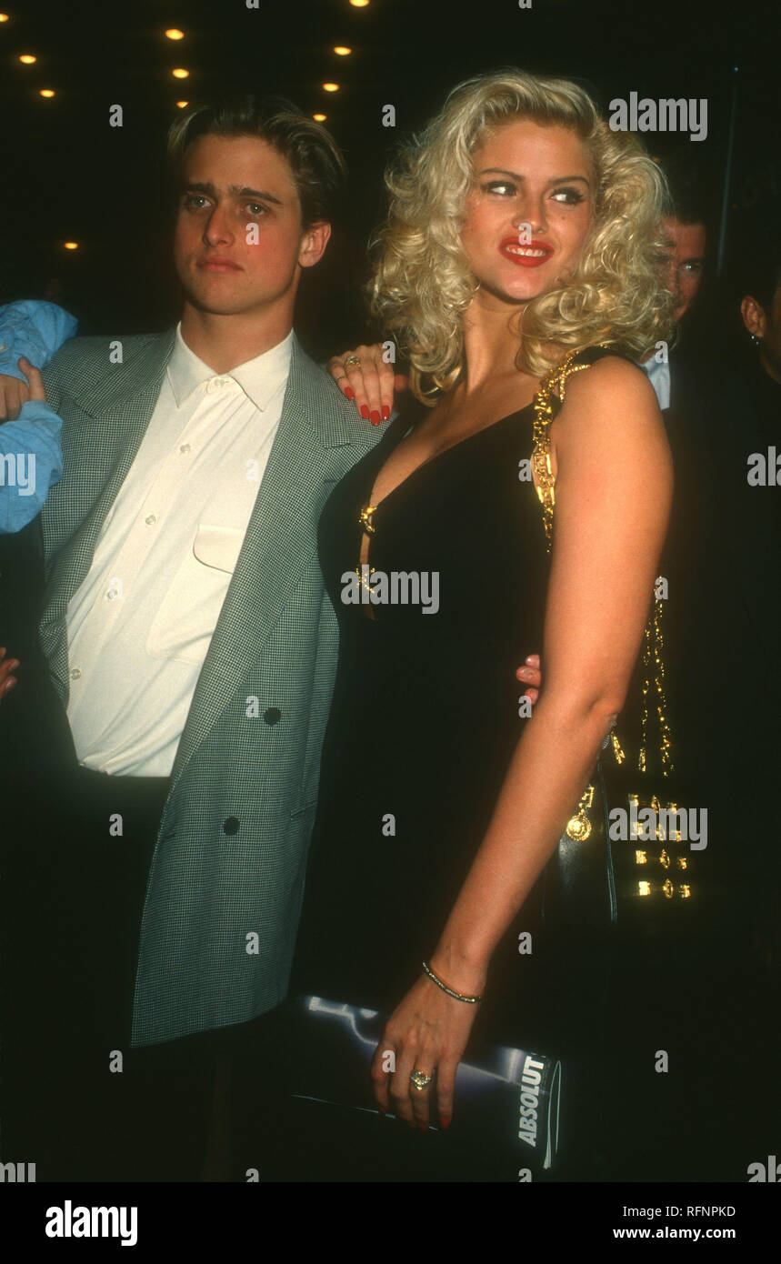 HOLLYWOOD, CA - NOVEMBER 11: Model/actress Anna Nicole Smith and brother Daniel Ross attend Opening Night Party for 'Guys & Dolls' on November 11, 1993 at Club Tatou in Hollywood, California. Photo by Barry King/Alamy Stock Photo - Stock Image
