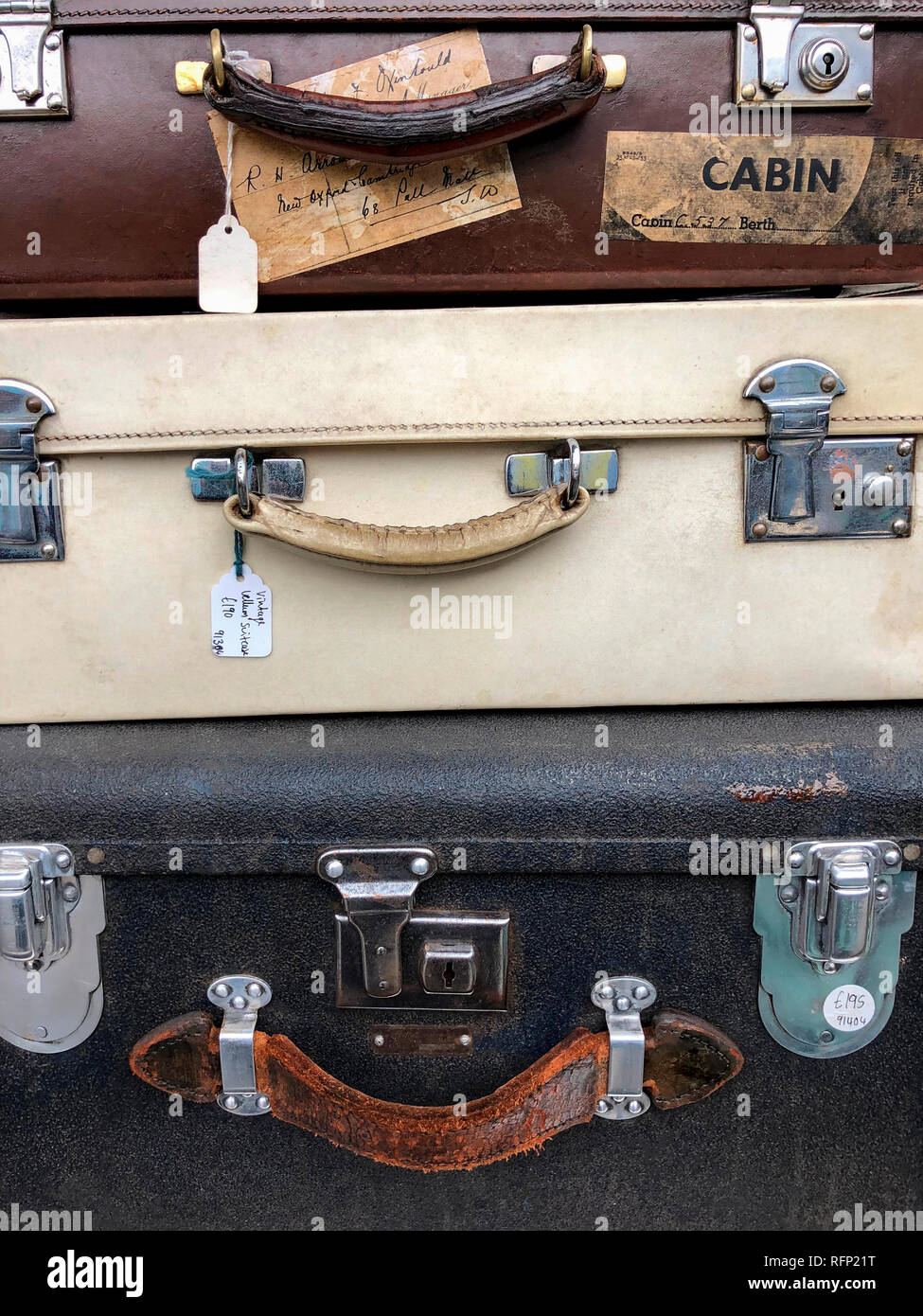 Old vintage suitcases for sale on a market in London, England. Stock Photo