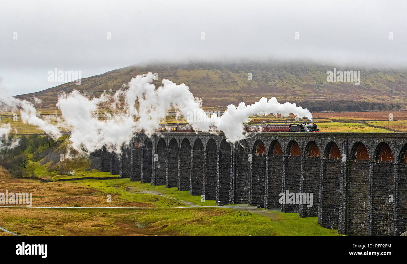 The Winter Cumbrian Mountain Express, hauled by steam locomotive no. 45690 Leander, crosses the Ribblehead Viaduct in North Yorkshire. date: Saturday January 26, 2019. Photo credit should read: Peter Byrne/PA Wire - Stock Image