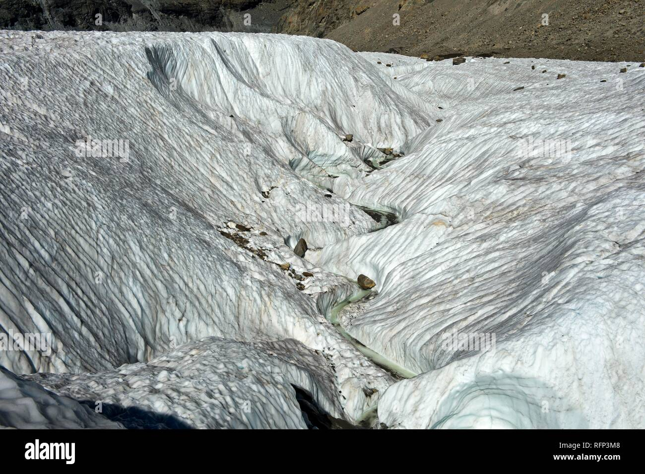 Wide crevasse on the Gorner Glacier, Zermatt, Valais, Switzerland - Stock Image