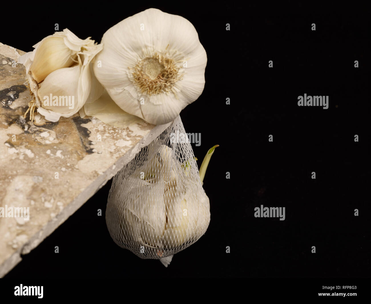 Garlic clove against a black background, vegetable food photograph Stock Photo