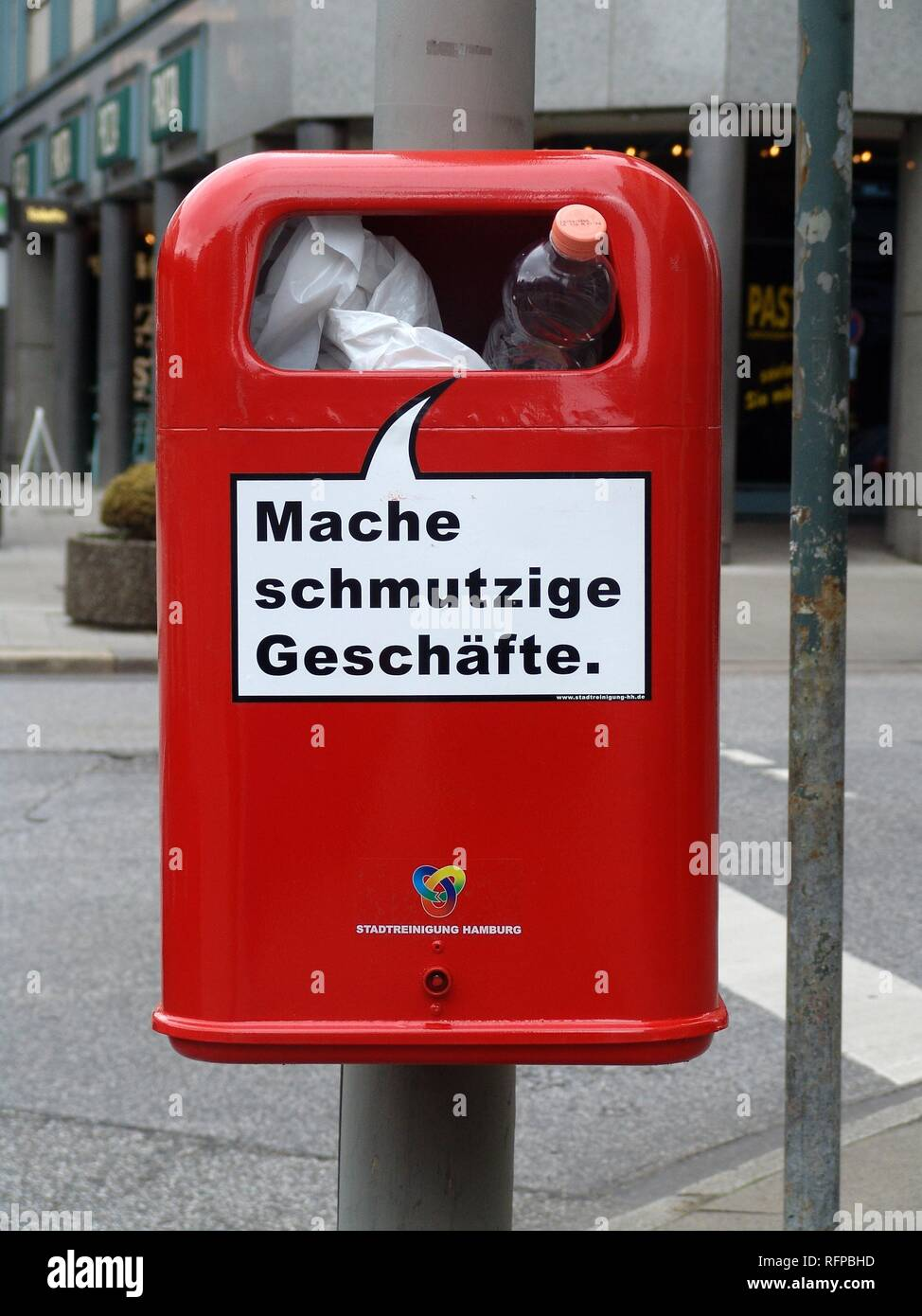 """DEU, Germany, Hamburg : Waste bin, garbadge bin in the city center with a funny slogan """"making dirty business"""". Stock Photo"""