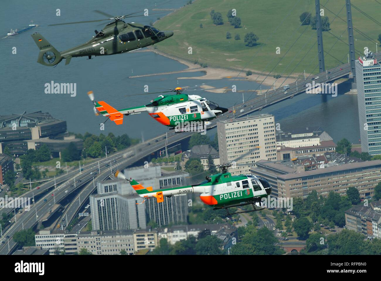 DEU, Germany, Duesseldorf: Police flying squad. Police helicopters.Top Eurocopter EC 155, middle BK 117, below MBB BO 105 - Stock Image