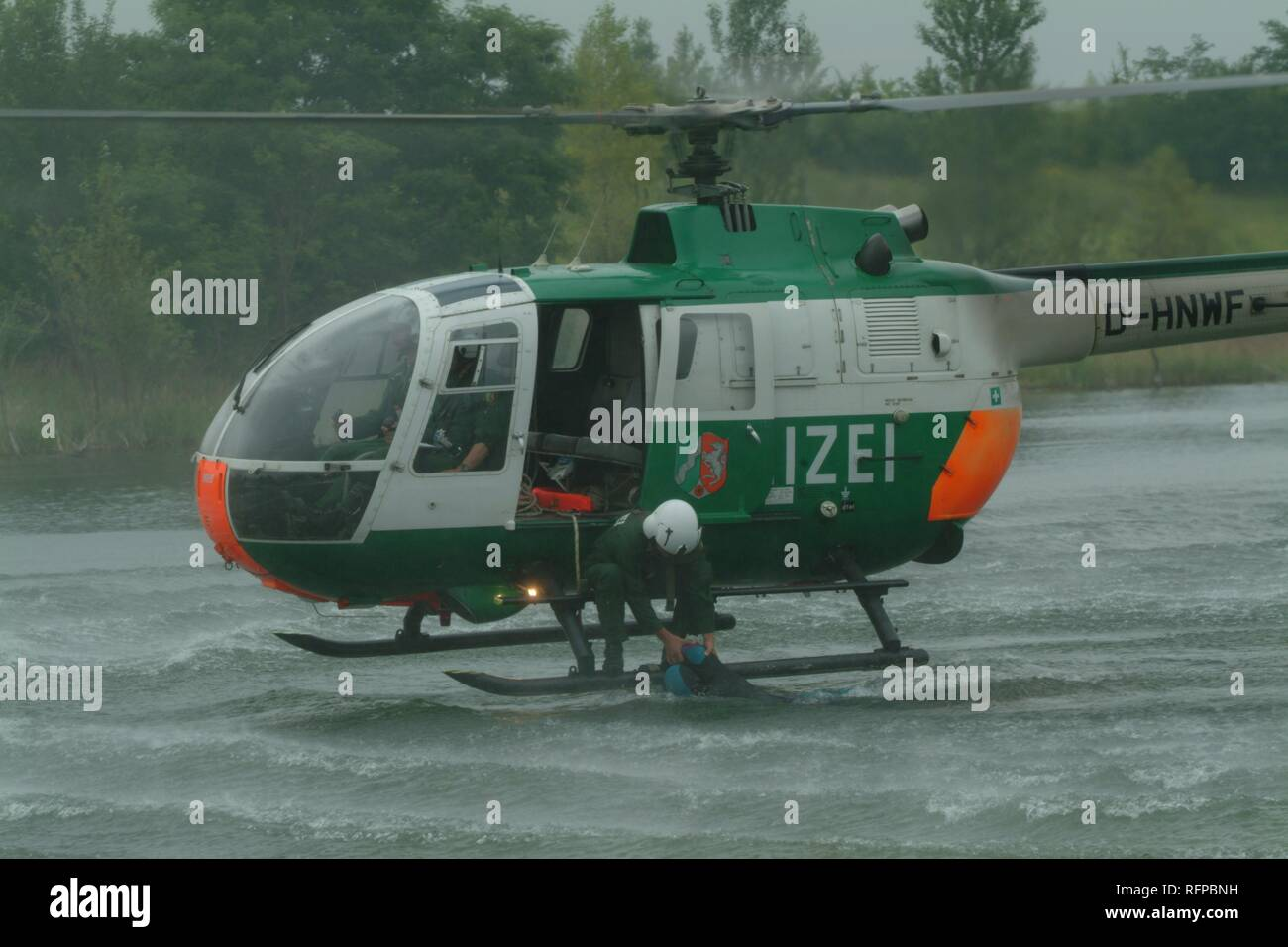 DEU, Germany, Duesseldorf: Rescue exercise, saving of people out of rivers or lakes. Police flying squad. Police helicopters. Stock Photo