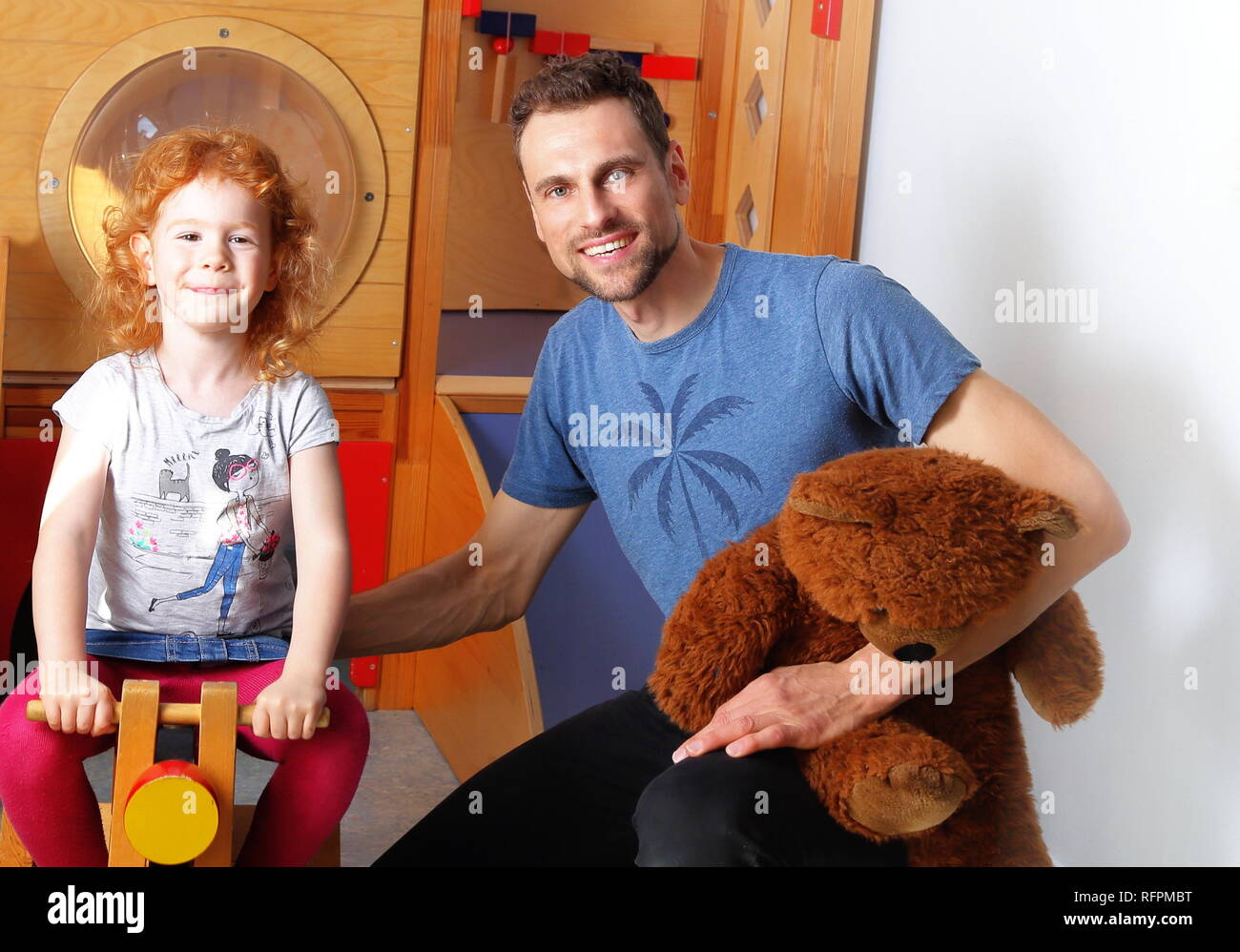 Male educator in Kindergarten Daycare Stock Photo