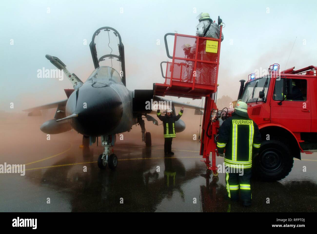 DEU, Federal Republic of Germany, Lagerlechfeld: Rescue exercise of the airport fire service of the german airforce. A fighter - Stock Image
