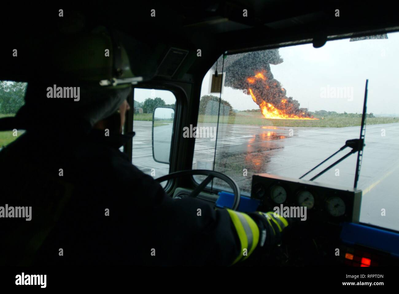 DEU, Federal Republic of Germany, : Rescue exercise of the airport fire service of the german airforce. A training petrol fire - Stock Image
