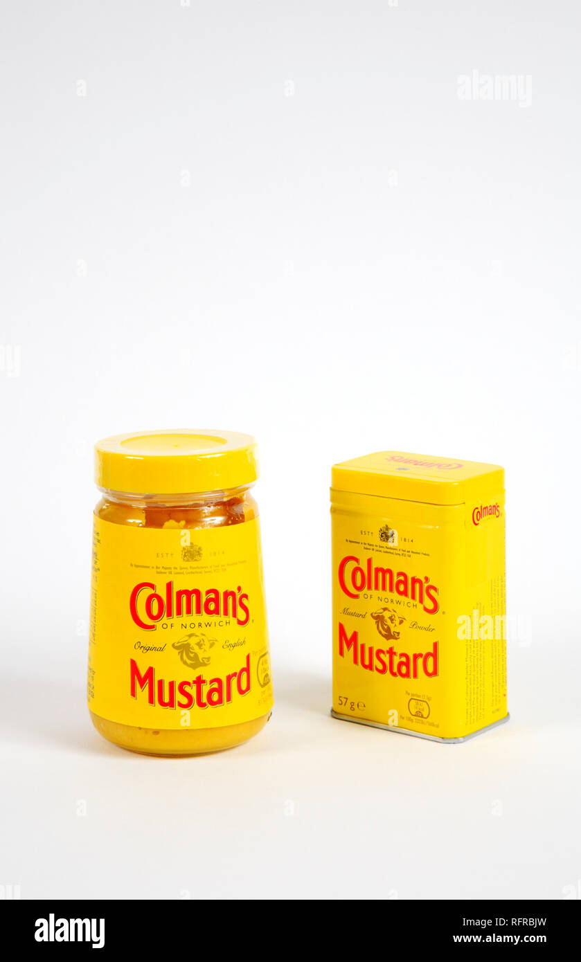 A jar of Colman's original ready made mustard and a tin of Colman's mustard powder by Colman's of Norwich for Unilever UK, Europe. - Stock Image