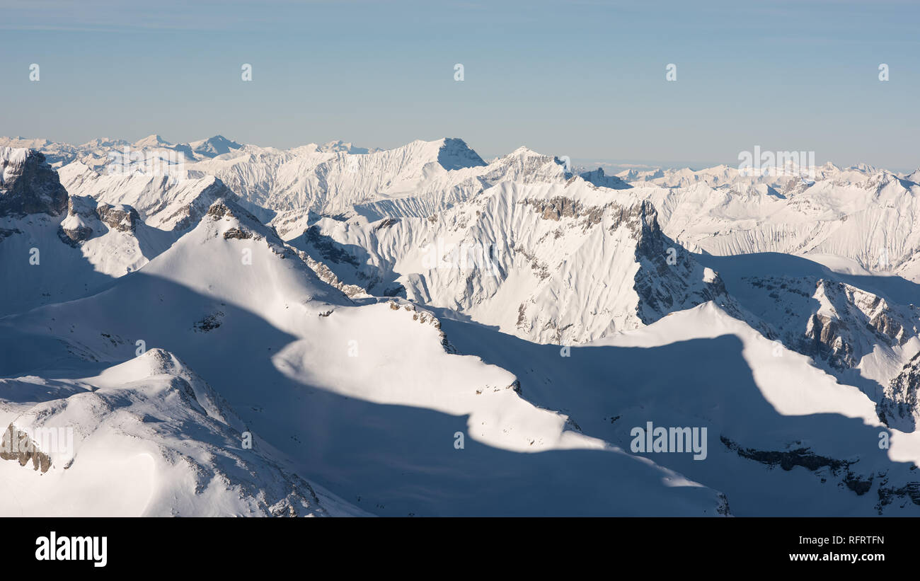 Alpine landscape on a wonderful cloud-free day in winter in the Swiss Alps, view from Schilthorn 2970m. - Stock Image