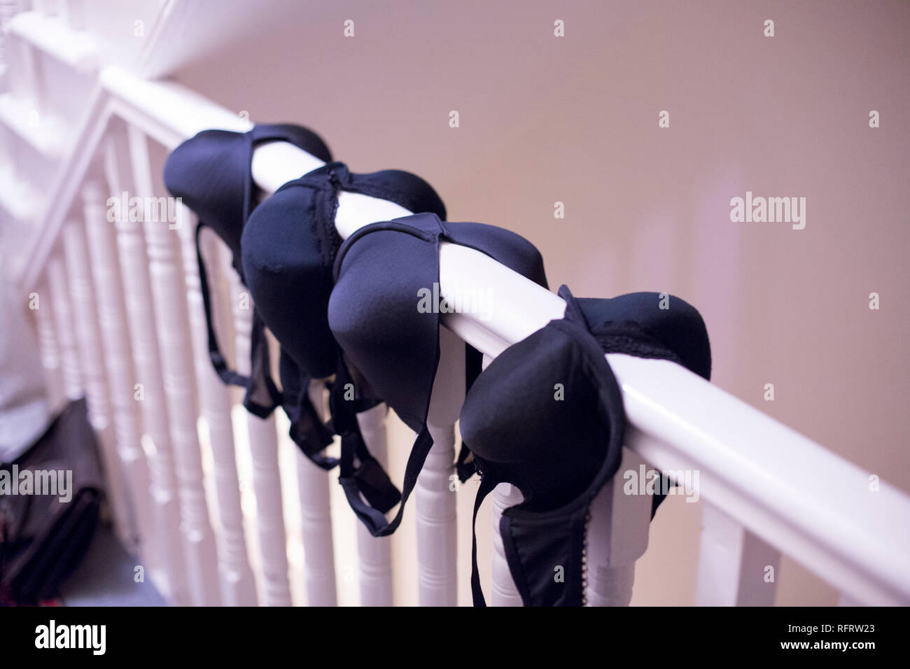 bras drying on the bannisters - Stock Image