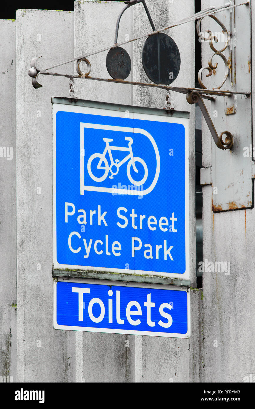 Blue sign on a multistorey vehicle park at Park Street, Cambridge, England, for the cycle park and toilets. - Stock Image