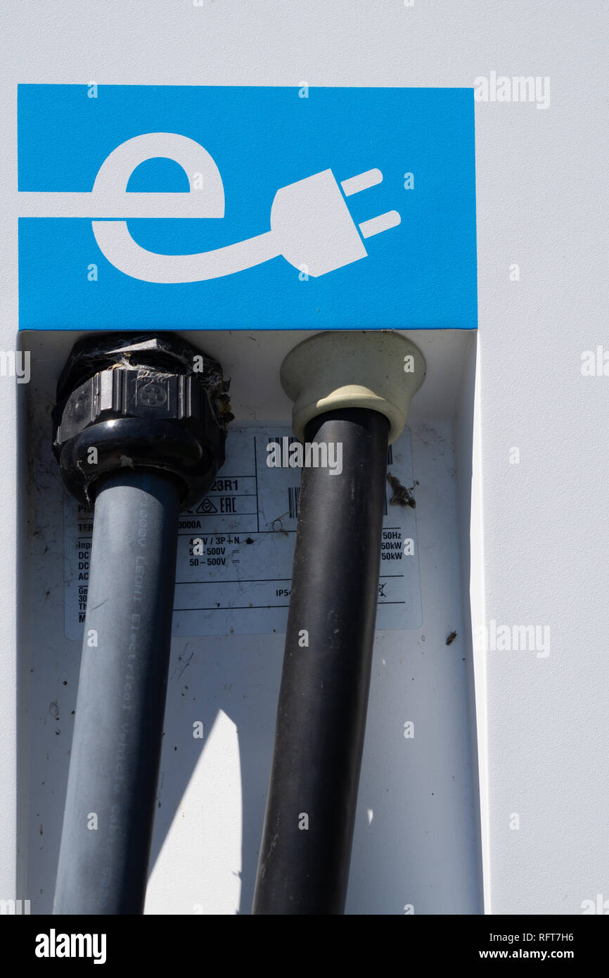 RAKAIA NEW ZEALAND - OCTOBER 13 2018; Symbol of electric car public recharge station graphic white electric cable and plug closeup - Stock Image