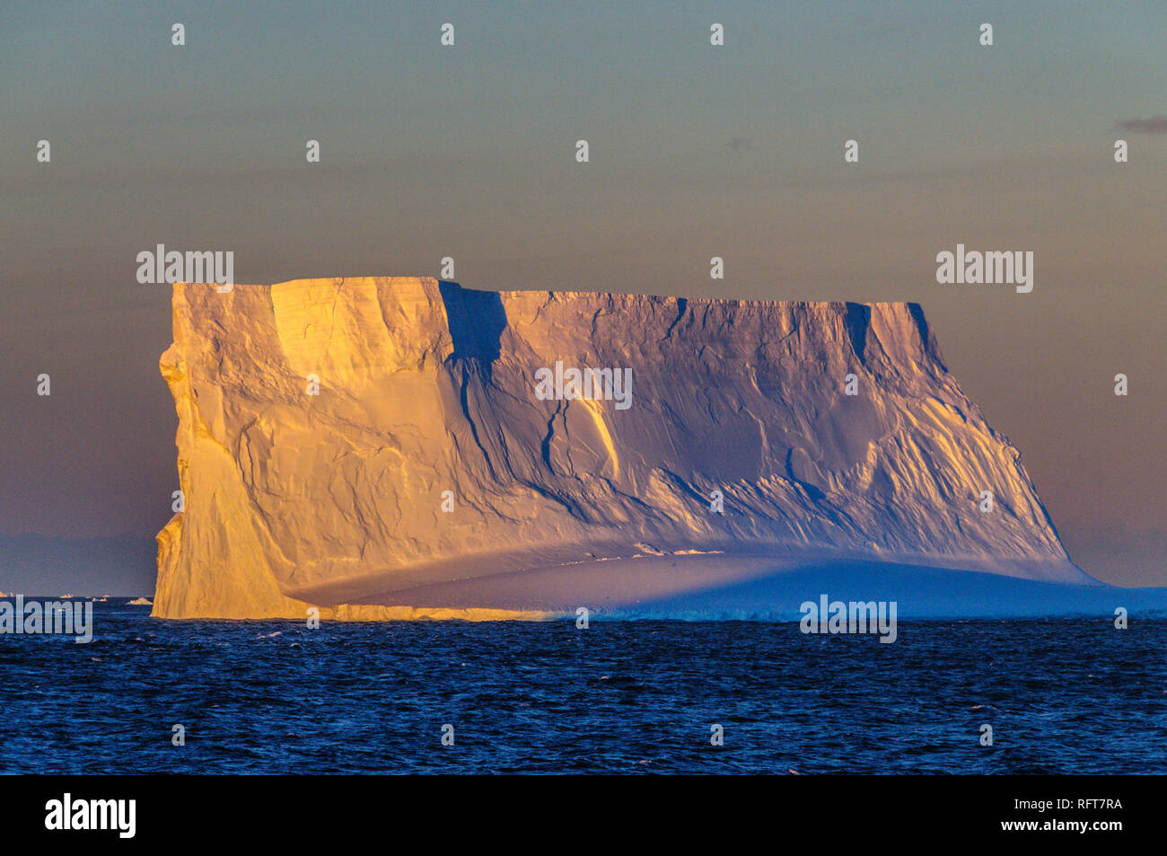 Antarctic Sunset: Floating Icebergs in the Weddell Sea, near the Antarctic Peninsula, as seen from an Antarctic Exploration Ship Stock Photo