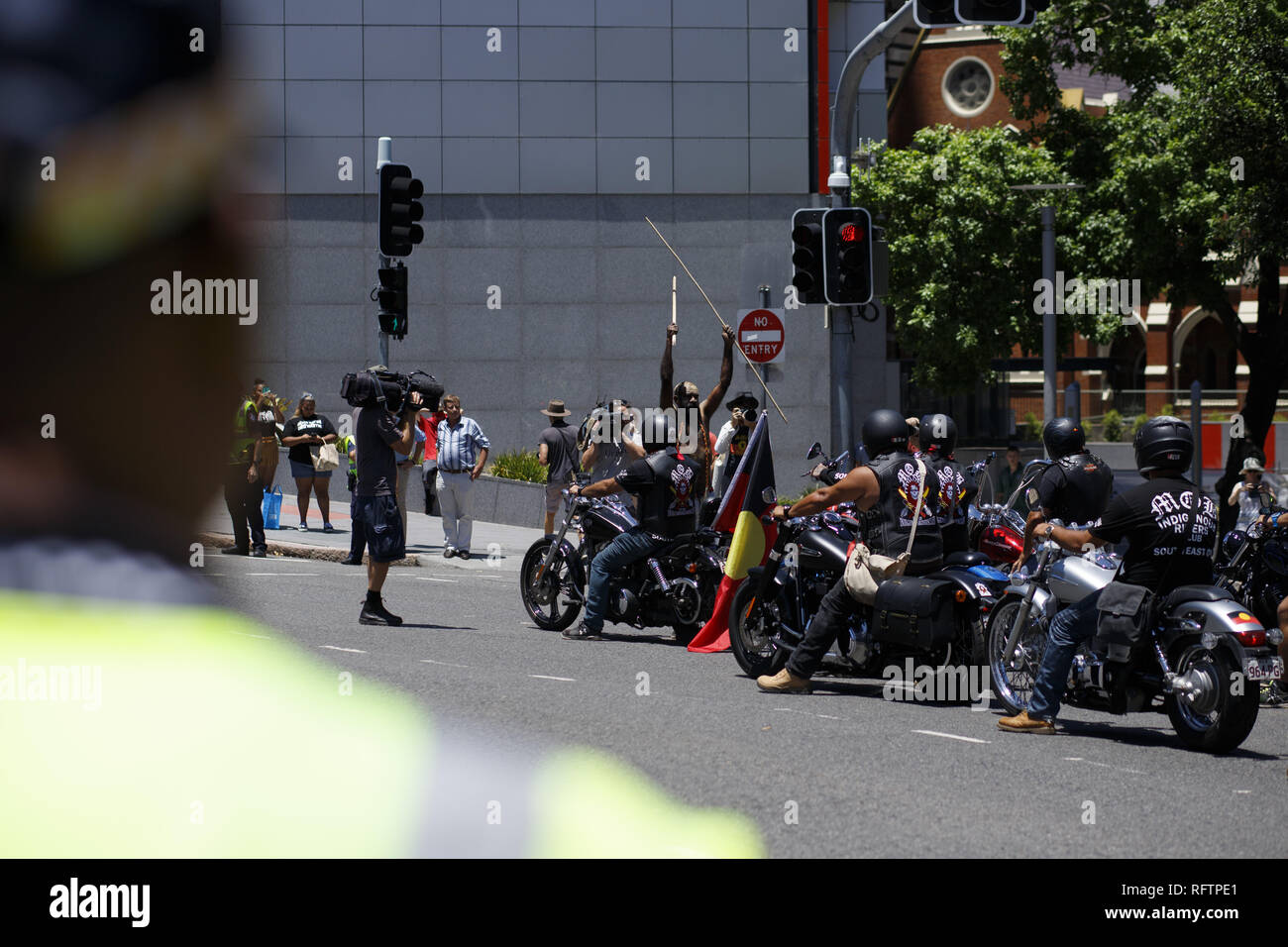 Brisbane, Queensland, Australia. 26th Jan, 2019. Protesters and the Indigenous Riders Club continue the march through the city at the rally on Roma Street. Indigenous protester Kamailie can be seen raising a spear among the crowd. On the 26th of January, many Australians celebrate Australia day, but to many indigenous Australian people, it is a day synonymous with decades of systematic abuse and genocide. Several thousand protesters took the streets in Brisbane (known as Meanjin by local indigenous people) to rally for sovereignty rights and date changes. (Credit Image: © Joshua Prieto/SO - Stock Image