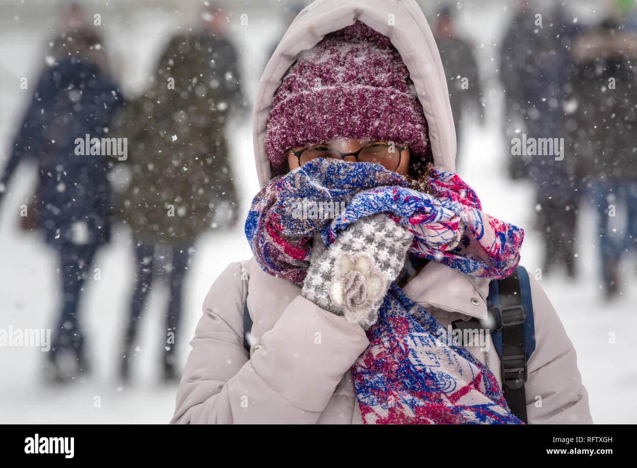 People walking in central Moscow during a heavy snowfall, Russia - Stock Image