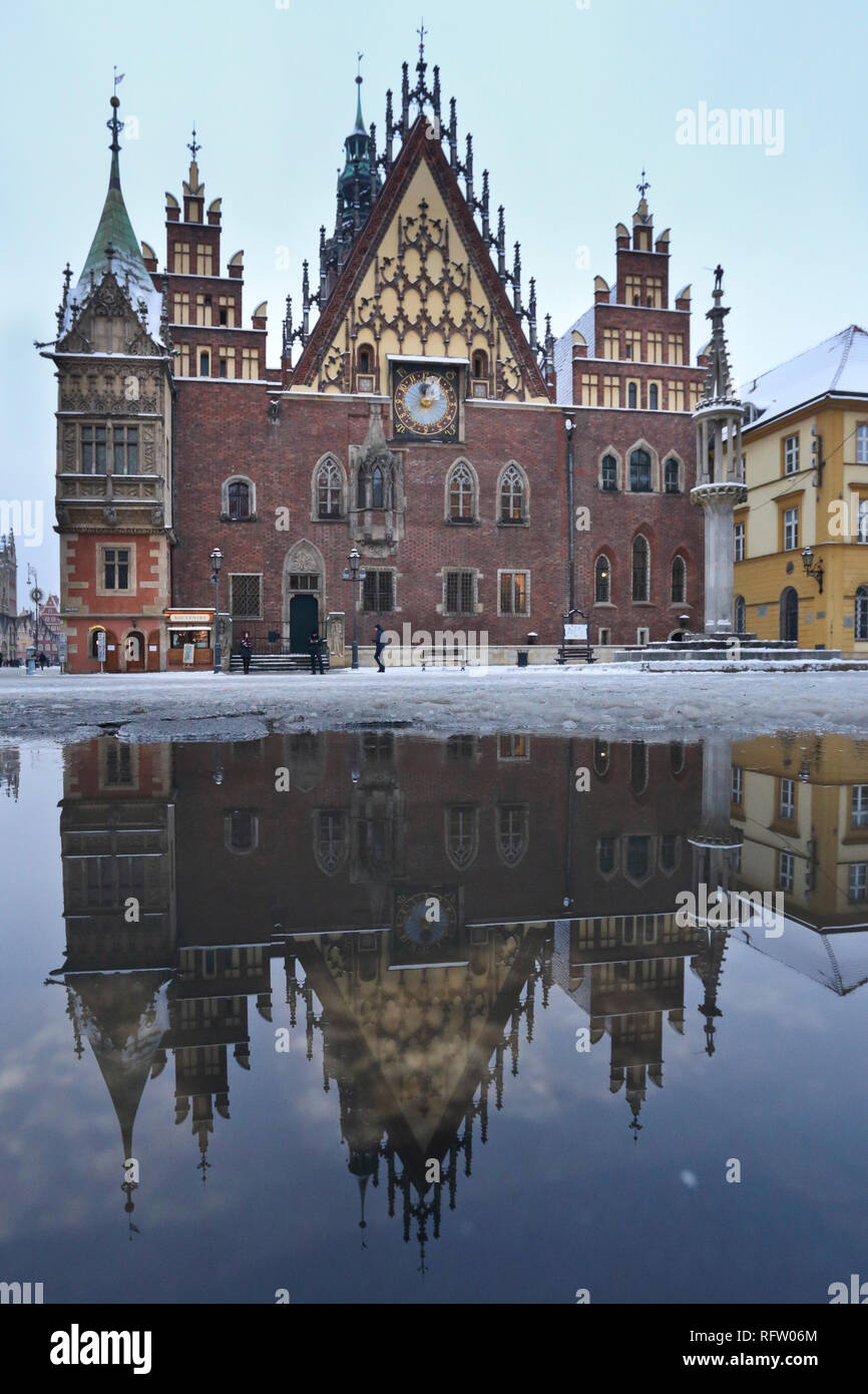 East Elevation of Old Town Hall at Market Square at its reflection in the paddle in Wroclaw, Poland - Stock Image