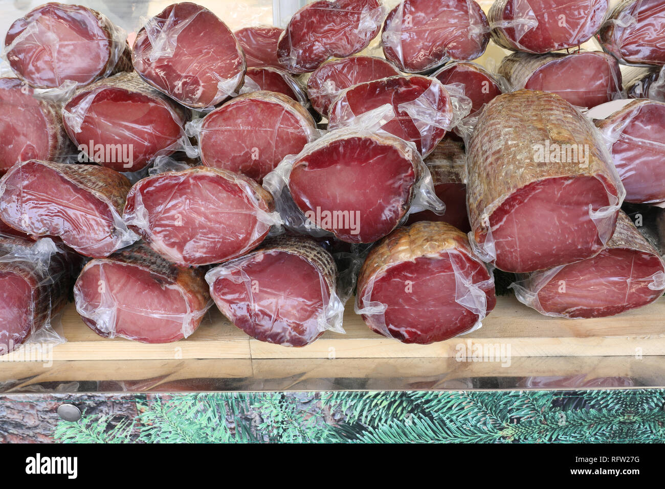 many smoked cold cuts for sale at italian kiosk - Stock Image
