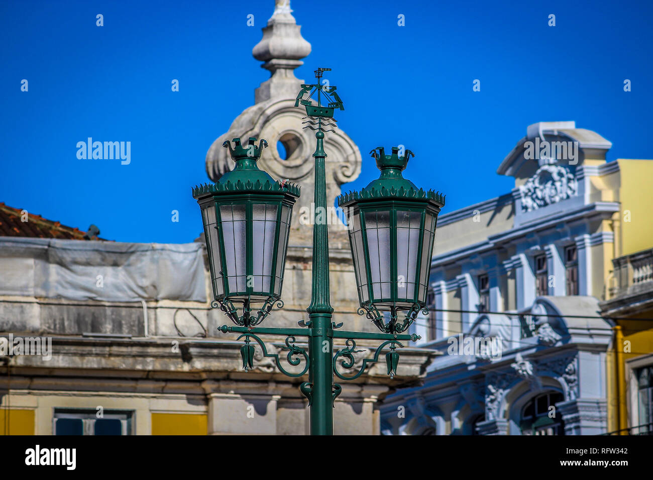 Vintage street lamps on the Commerce square, in Lisbon, Portugal Stock Photo