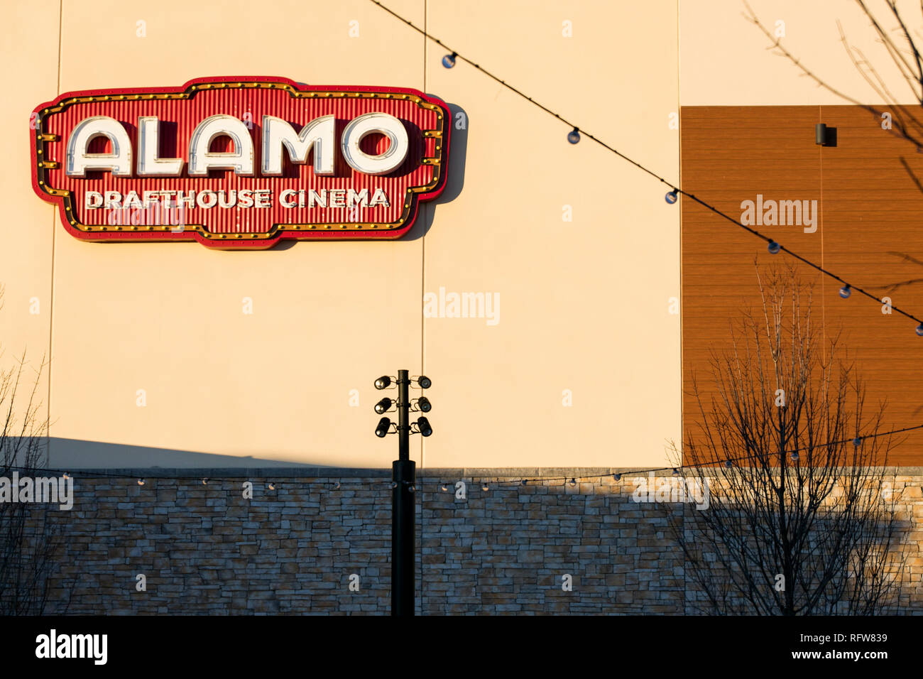 A logo sign outside of an Alamo Drafthouse Cinema location in Woodbridge, Virginia, on January 21, 2019. - Stock Image