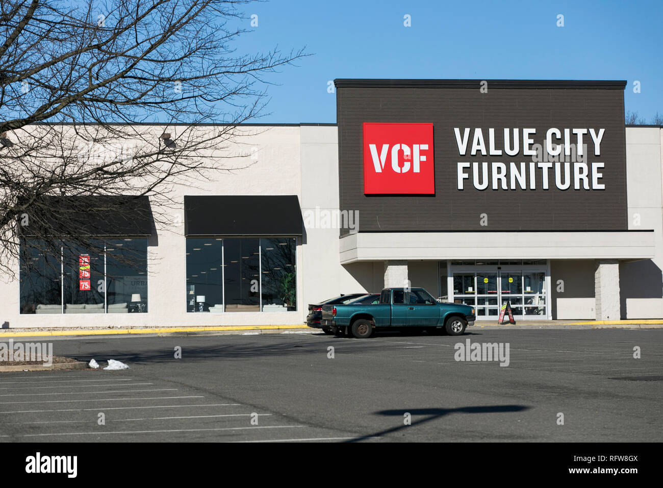 A Logo Sign Outside Of A Value City Furniture Retail Store Location