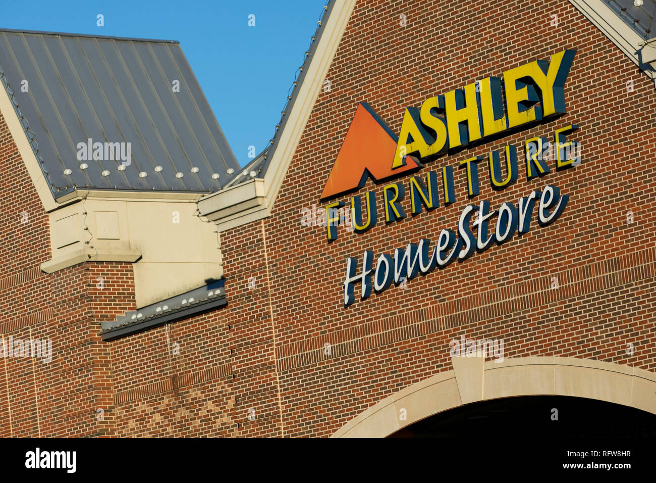 A Logo Sign Outside Of A Ashley Furniture HomeStore Retail Store In  Frederick, Maryland,