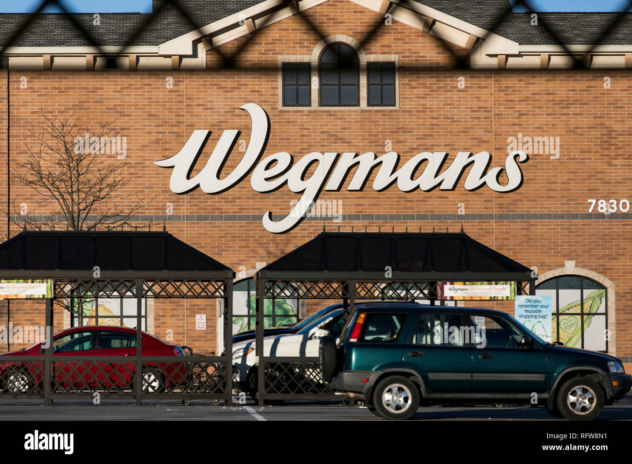 A logo sign outside of a Wegmans Food Markets grocery store in Frederick, Maryland, on January 22, 2019. - Stock Image