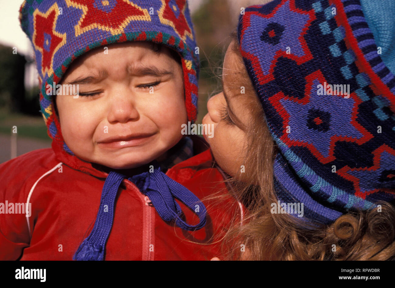 little girl consoling her crying sister - Stock Image