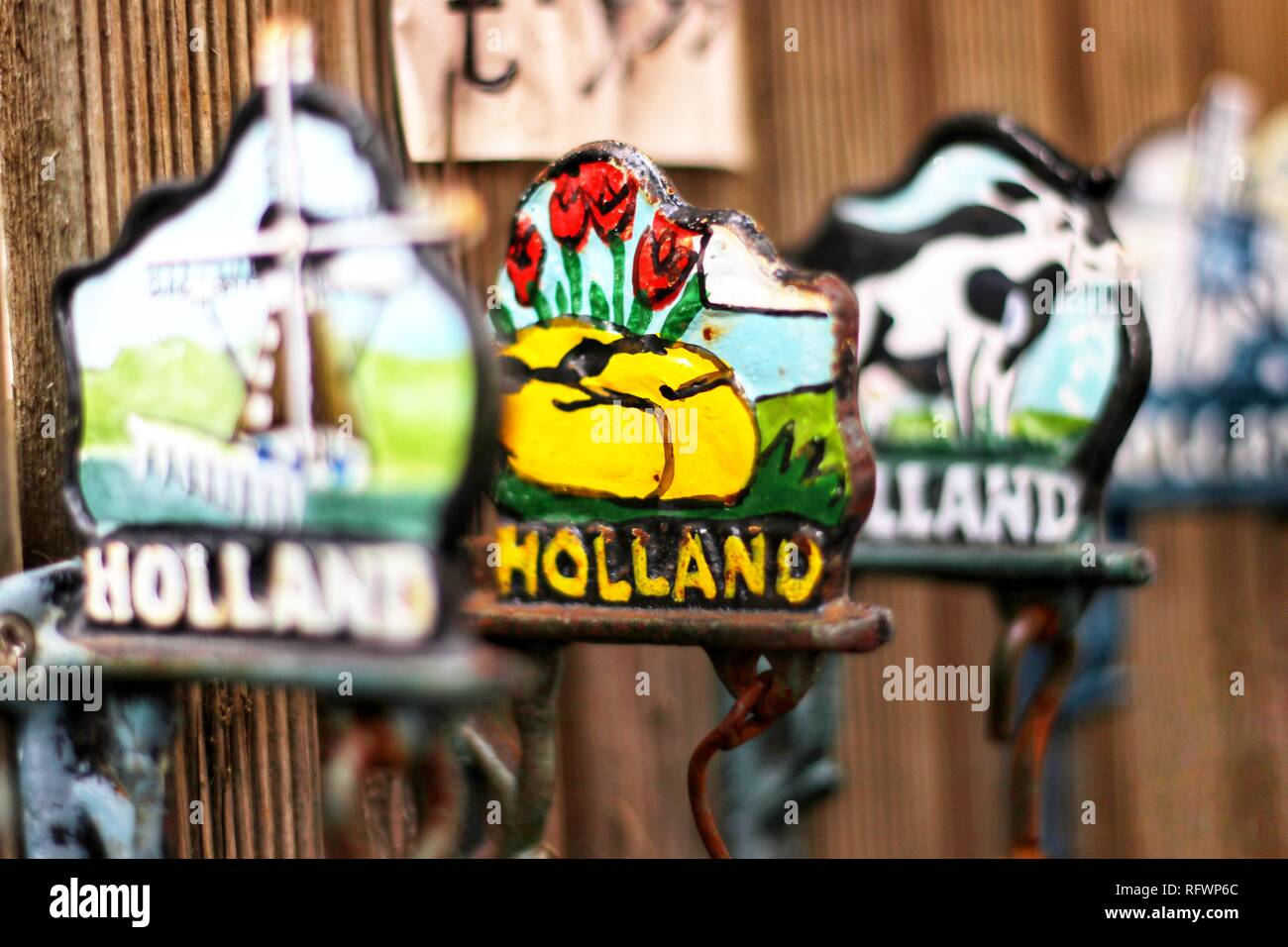 Colourful tourist souvenirs with the word Holland in bold lettering, Amsterdam Flower Market, The Netherlands, Europe. - Stock Image