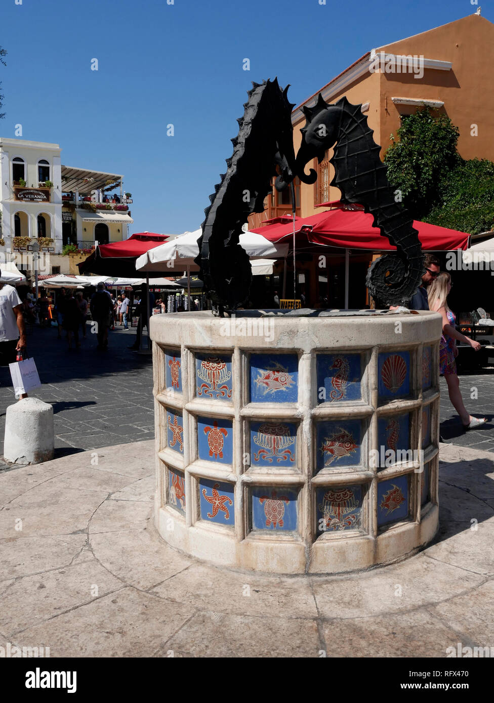 The former Jewish Quarter in Rhodes with the memorial to the Nazi holocaust Victims and the Seahorse Fountain near the Kahal Shalom Synagogue - Stock Image