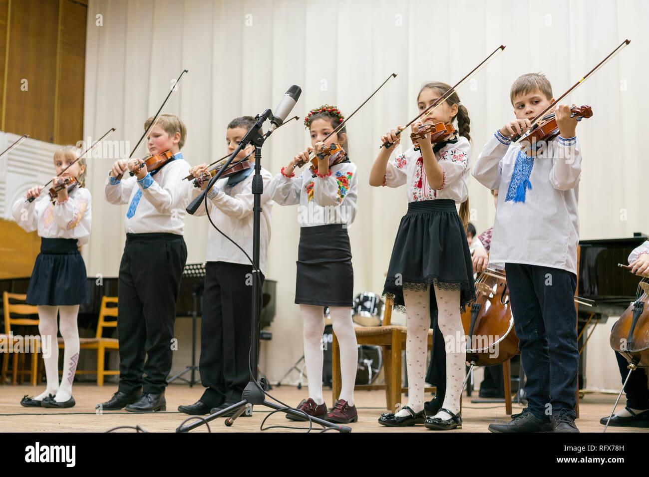 Kiev, Ukraine. January 21 2019 Children's violin ensemble. Children with violins on stage. Children's initiative, small talents. Early child developme - Stock Image